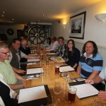 dinner-at-the-cricket-inn-devon-and-norwegian-fishers-discuss-the-finer-points-of-fishing-jan-andersen