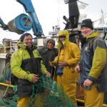 a-happy-crew-mending-their-nets