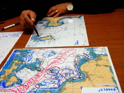 One fisher drawing a map during a mapping session to collect the LK.